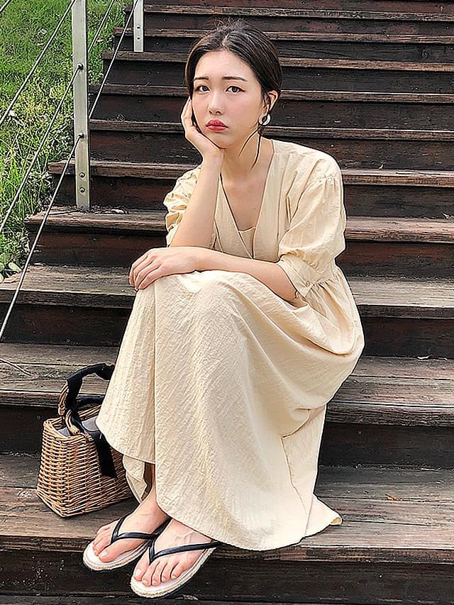 Long-sleeved dress banding back bending linen