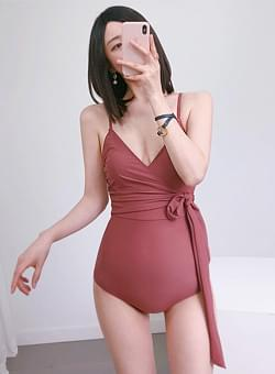 Down pink bathing suit