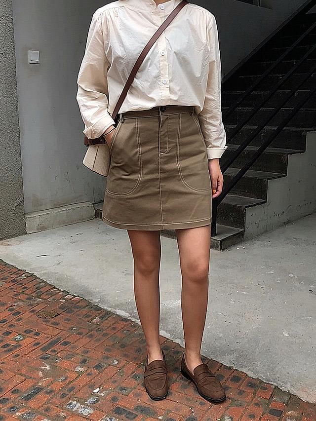 Brown stitch mini skirt