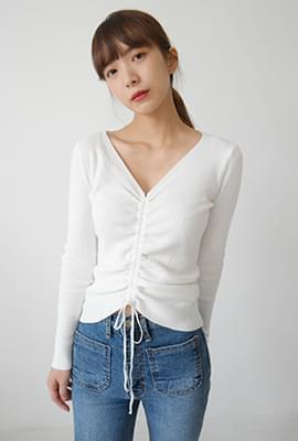 Feminine center string knit