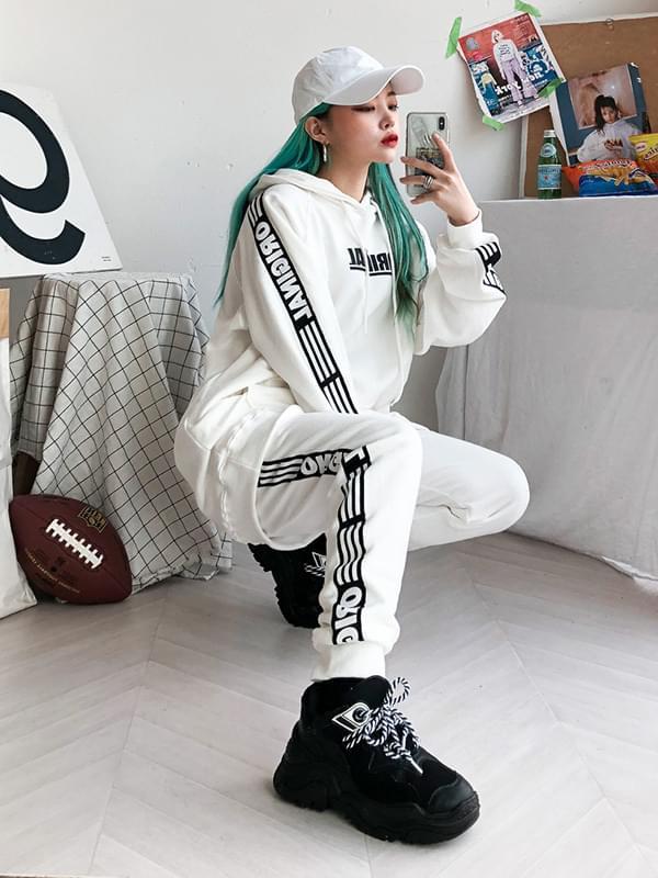 Black tape jogger pants