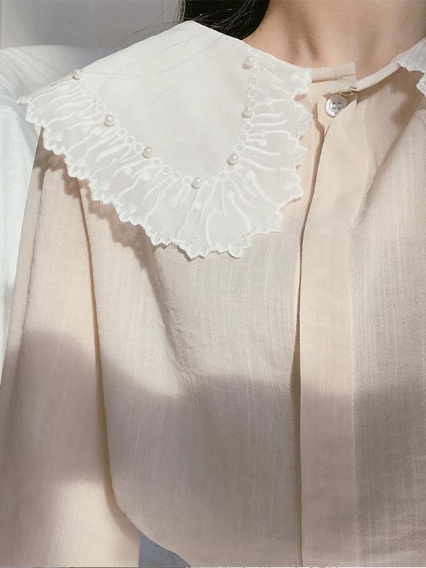 Powder pearl color blouse