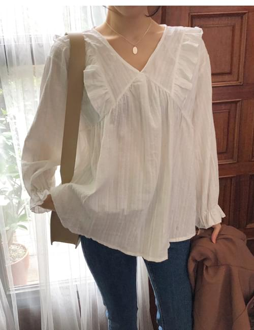 Cream and frilly blouse