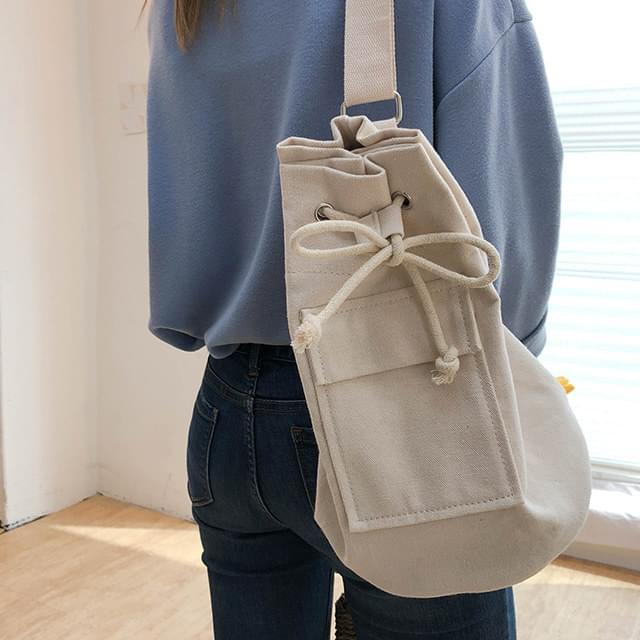 Cotton pocket shoulder bag and cross