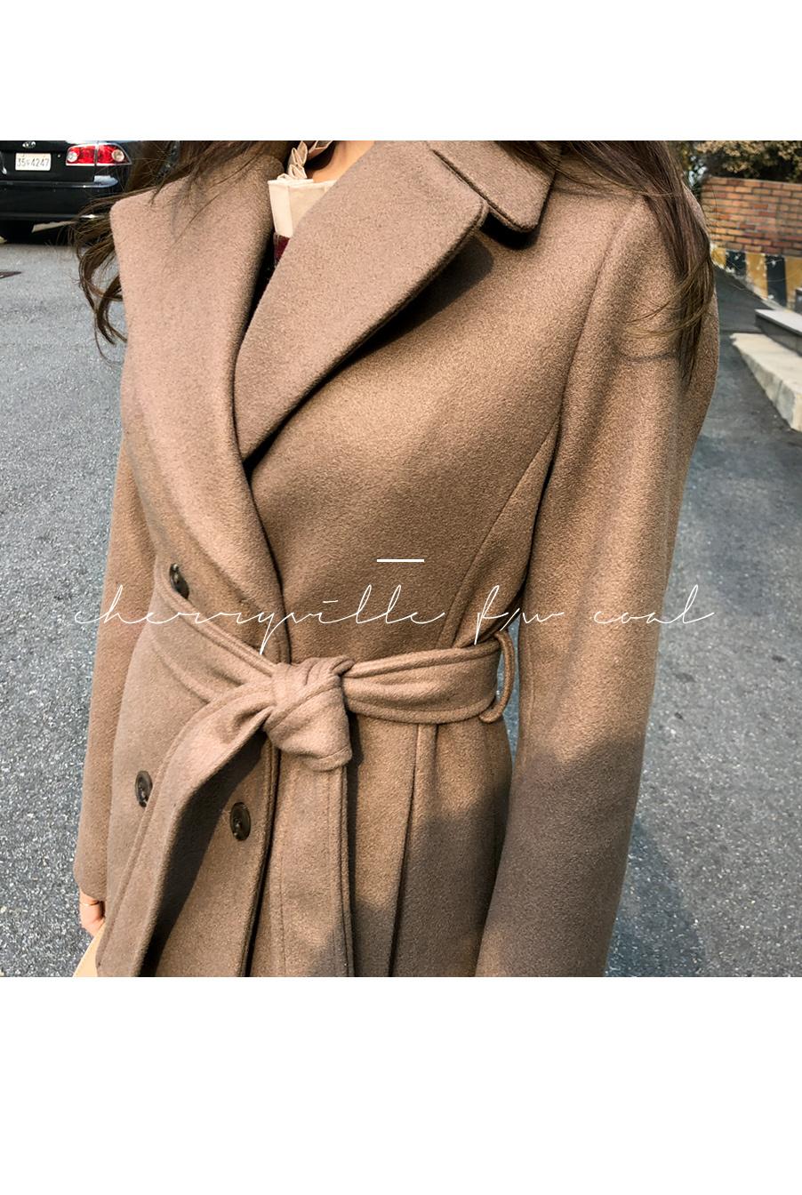 Nu Beam coat against line