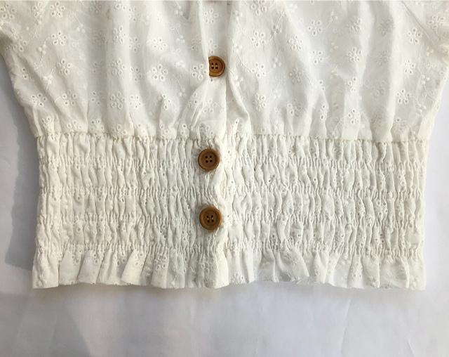 Cream off shoulder blouse
