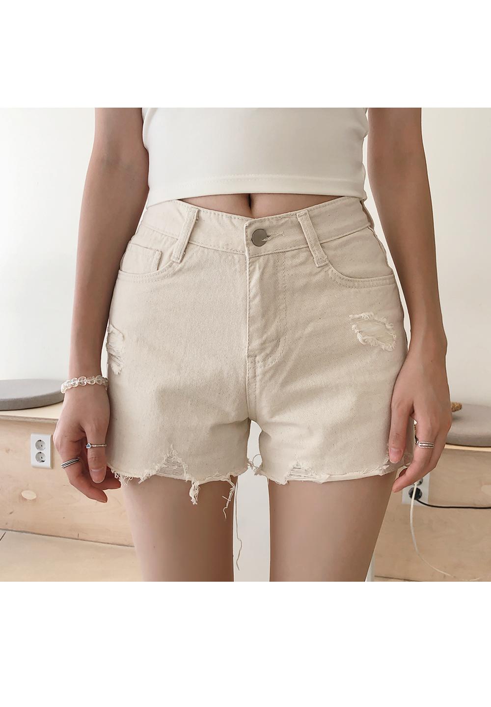 Cut beige pants