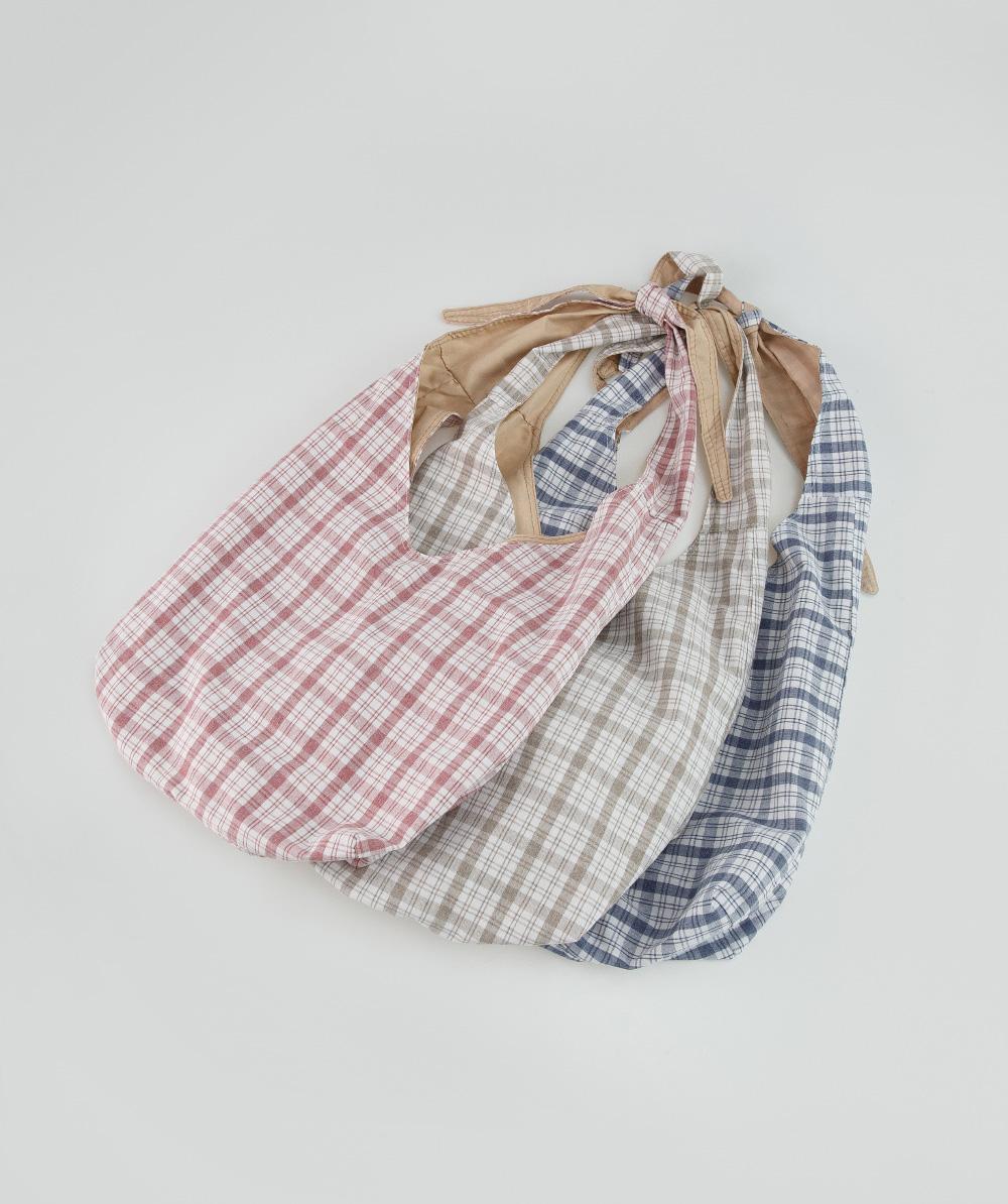 check pattern knots bag