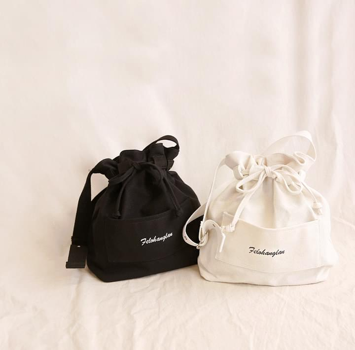 CLETA LETTERING BUCKET BAG