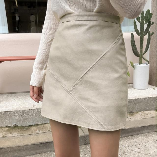 Inclined leather miniskirt-sk