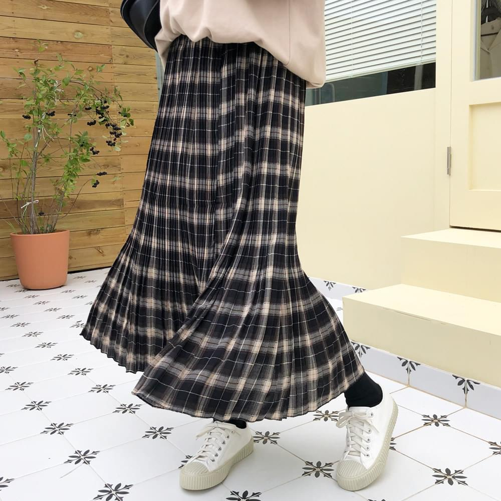 Impression check pleated skirt