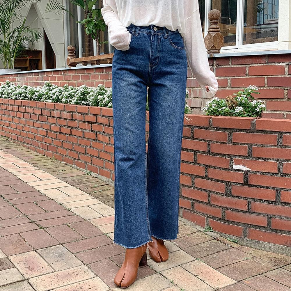 Hem-cutting wide denim pants