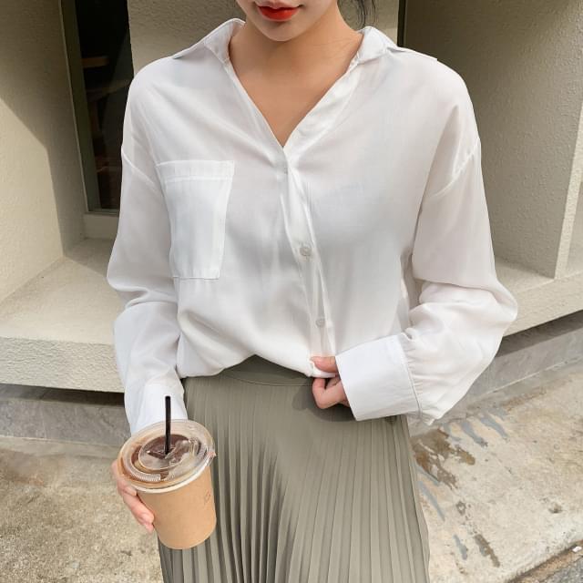 Unique diagonal button blouse