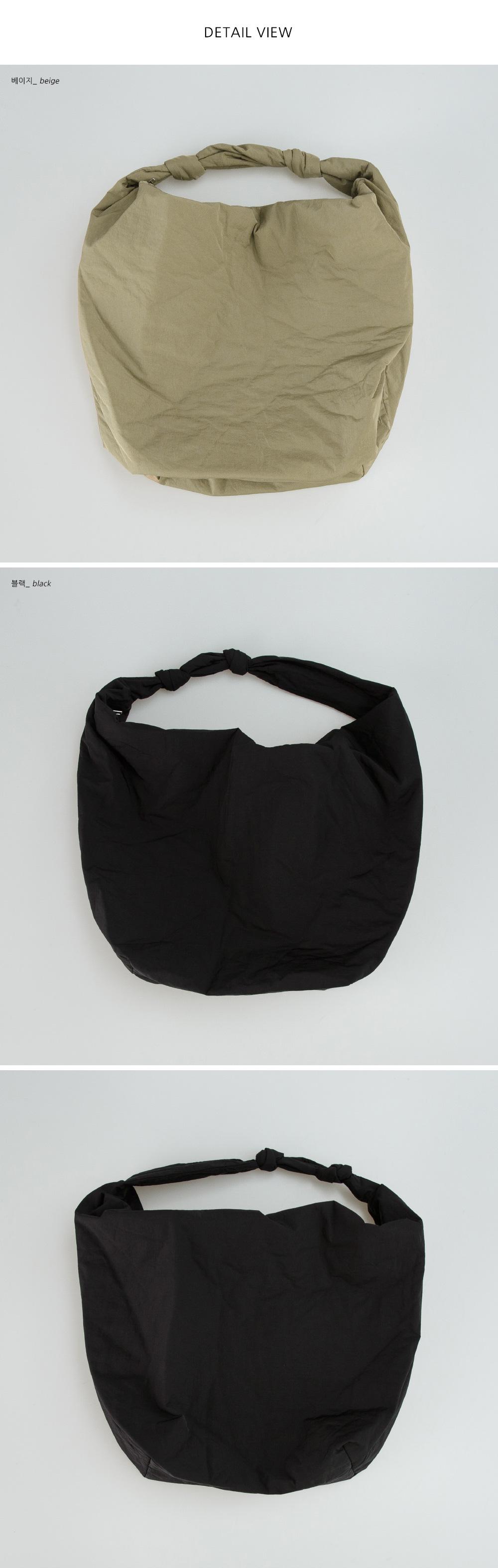 Note-zip padded shoulder bag