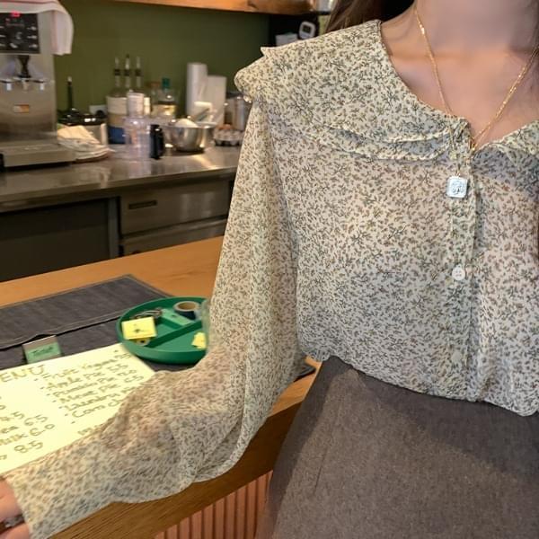Person flower blouse