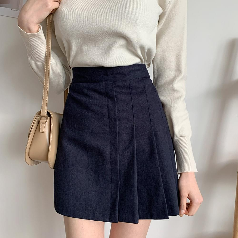 With in pleated miniskirt