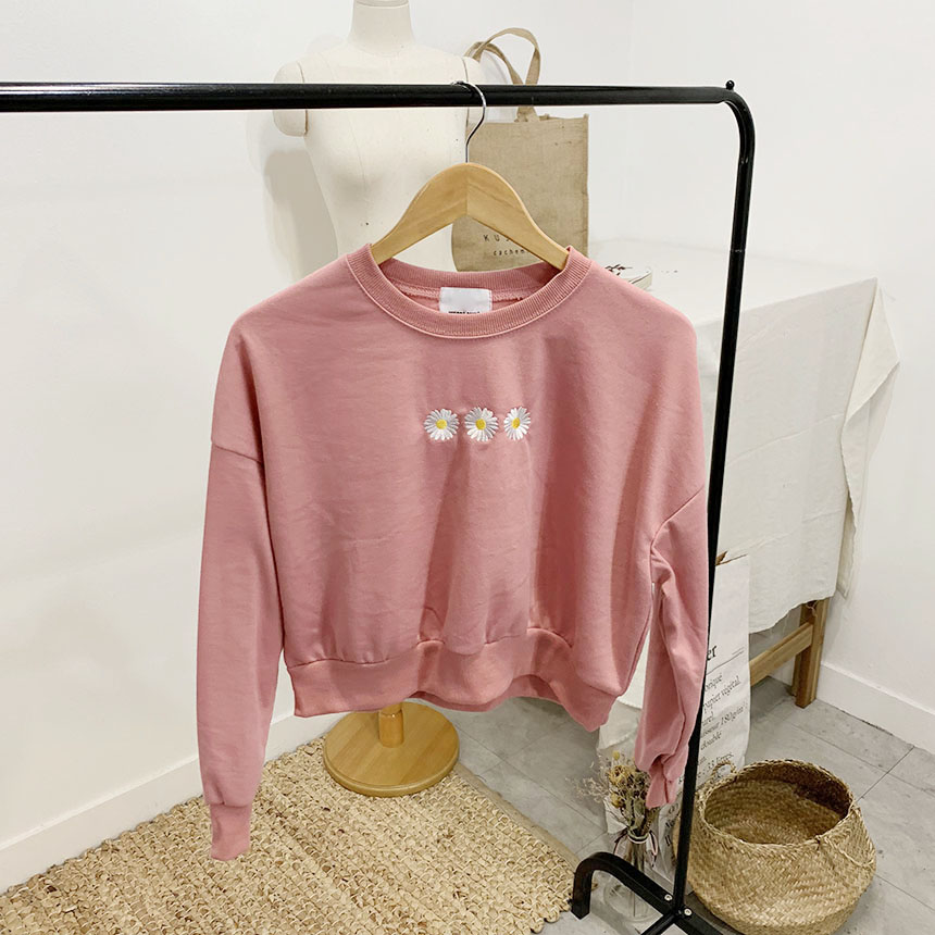 Blossom color embroidered round neck cropped sweat shirt
