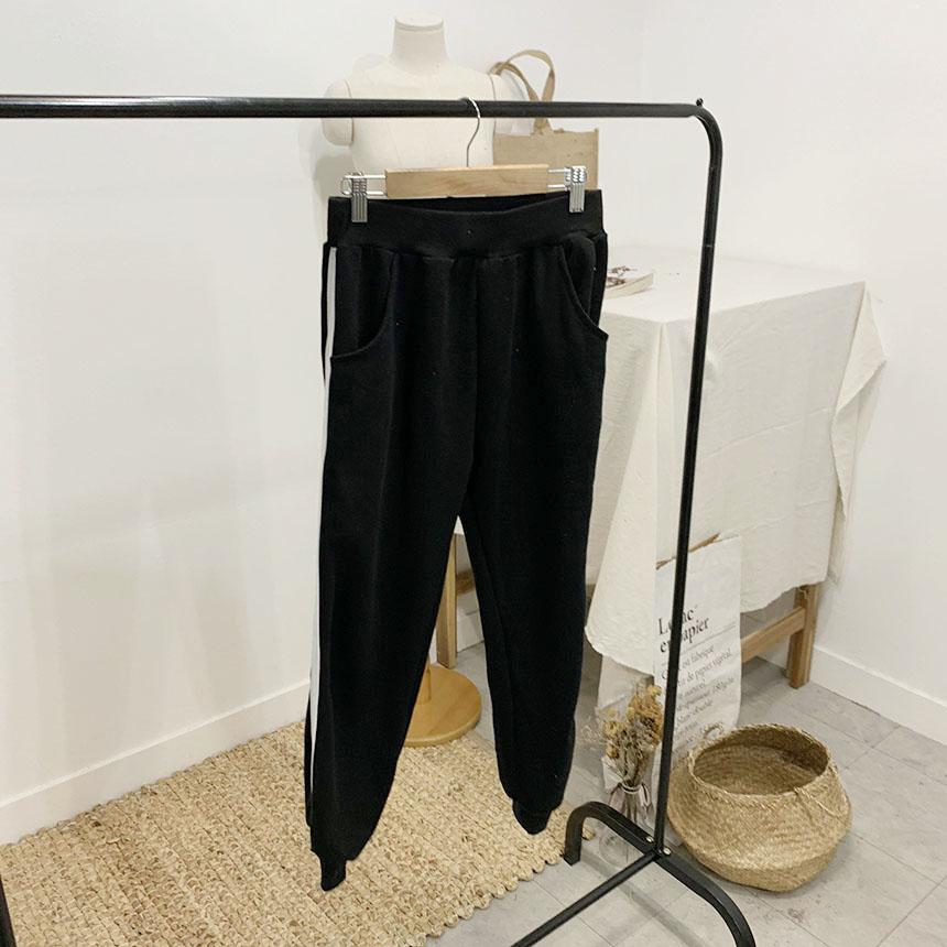 On duffel color line training pants