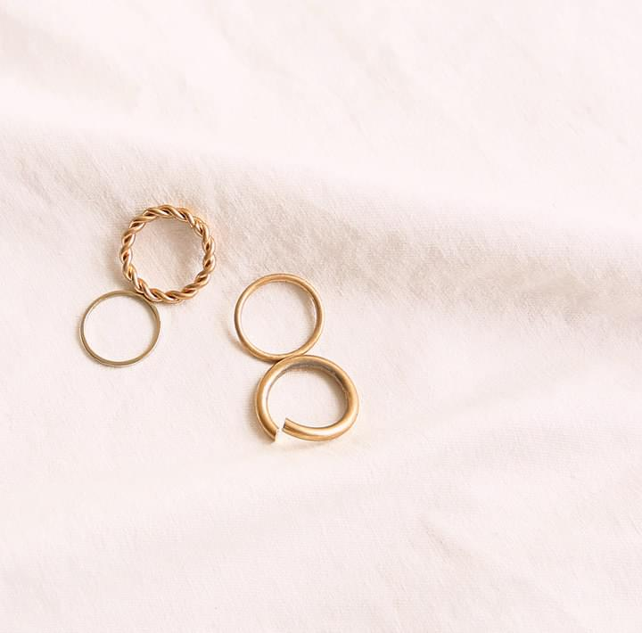 TWIST GOLD LAYERED RING 4 SET