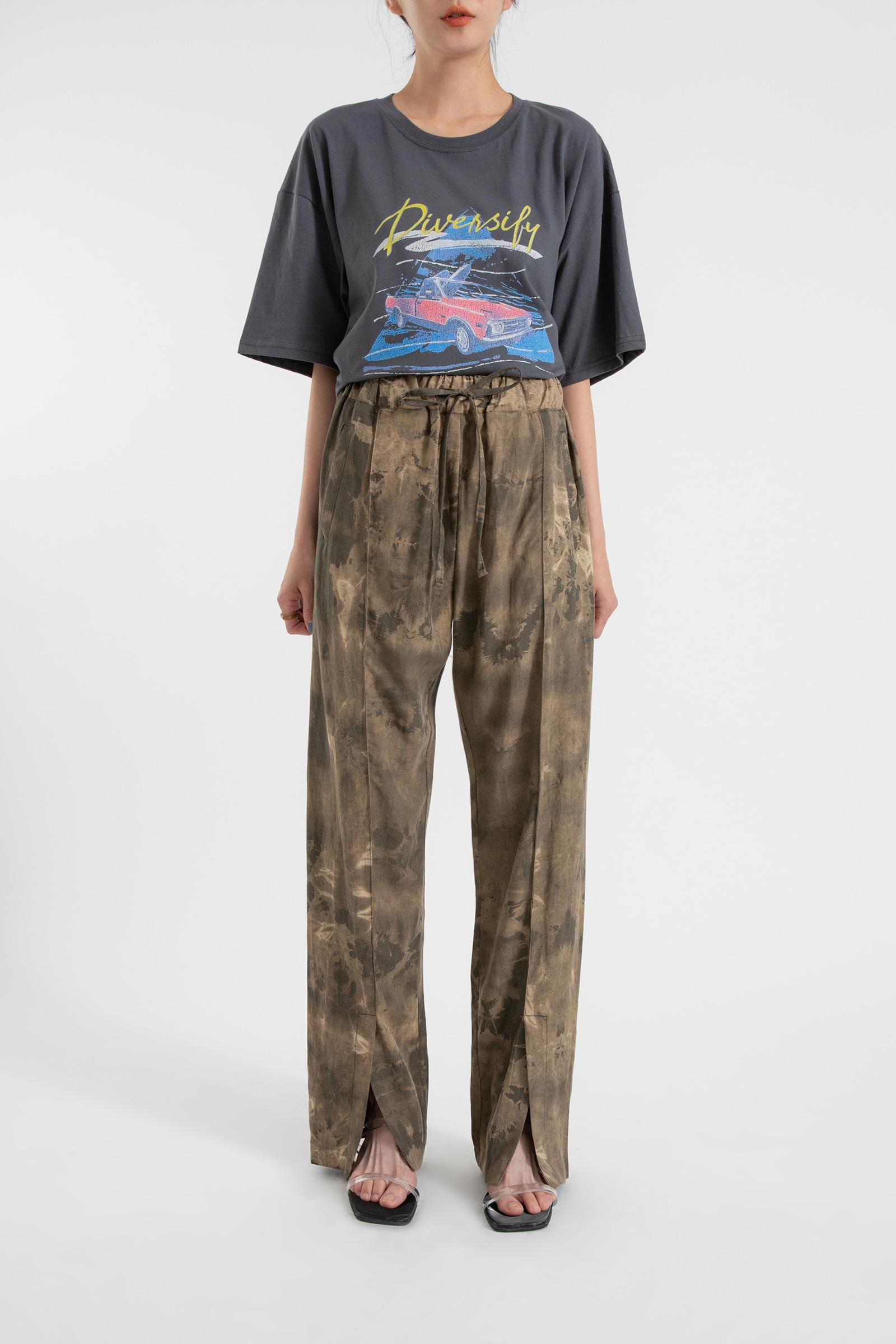 Wild slit tie-dye linen trousers