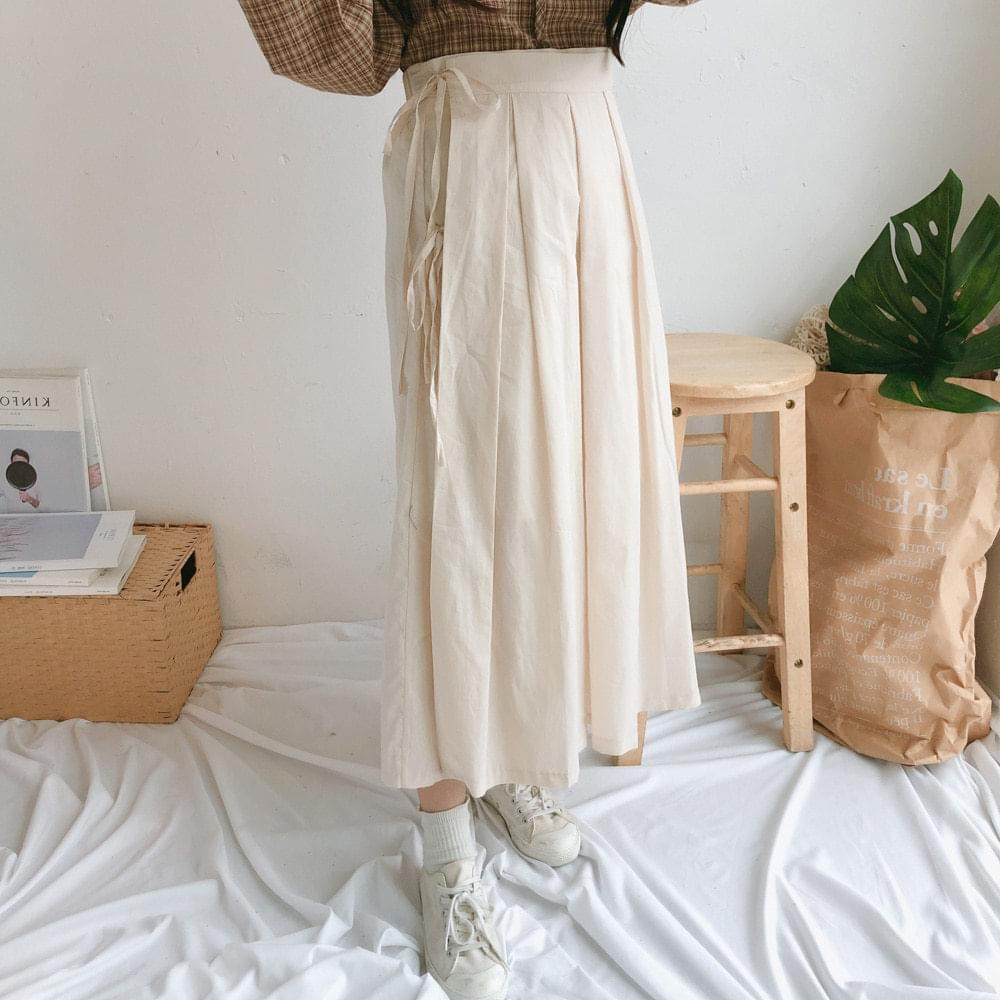Somi pleated long wrap skirt