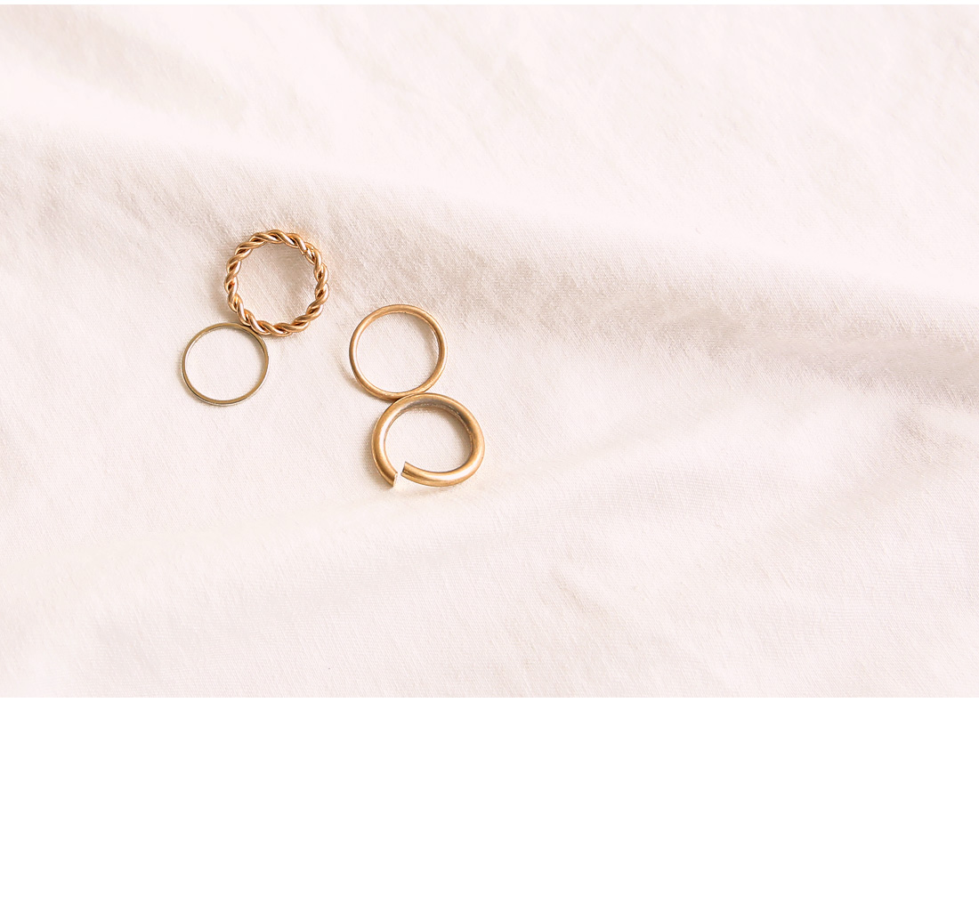 TWIST GOLD LAYERED RING 4 SET