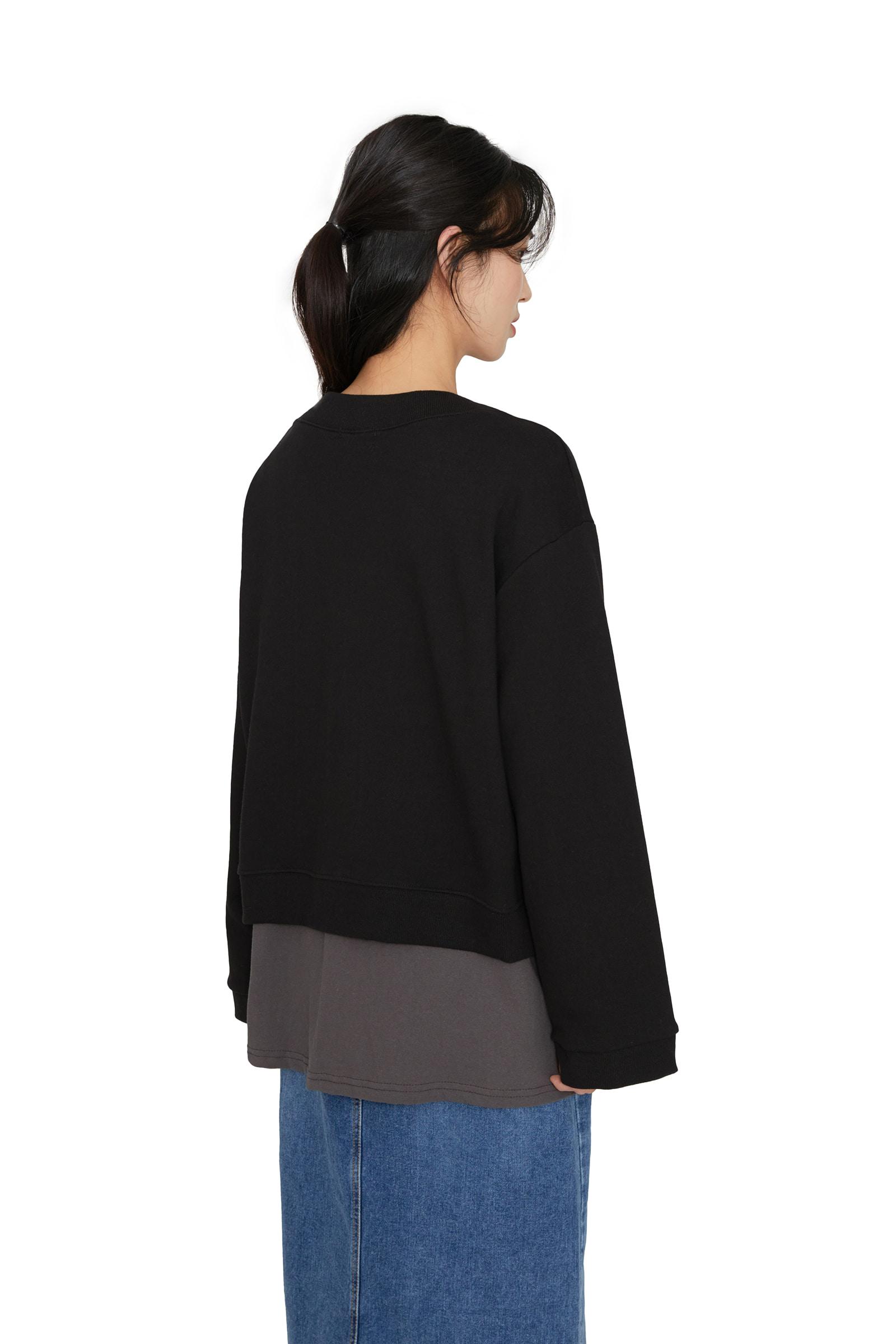 Hearth button over v-neck cardigan