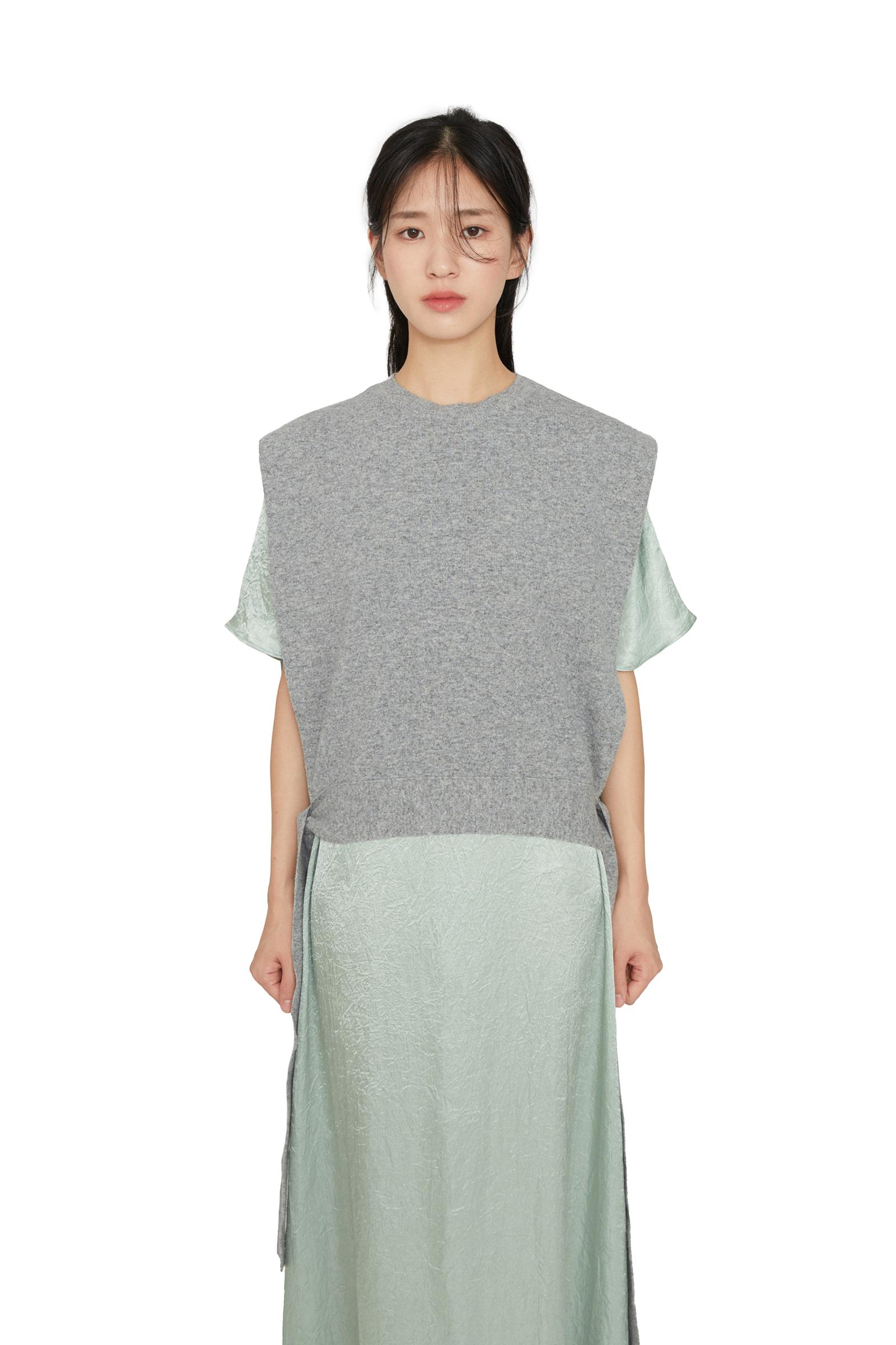 Fuzzy wool strap over knit vest