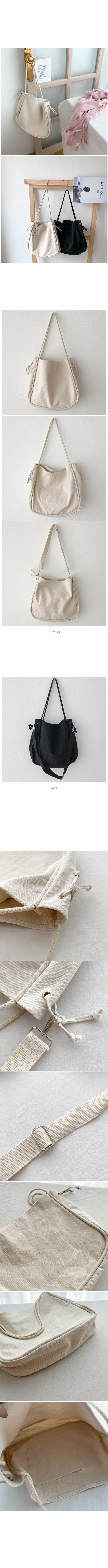 Tag on cotton shoulder and cross bag