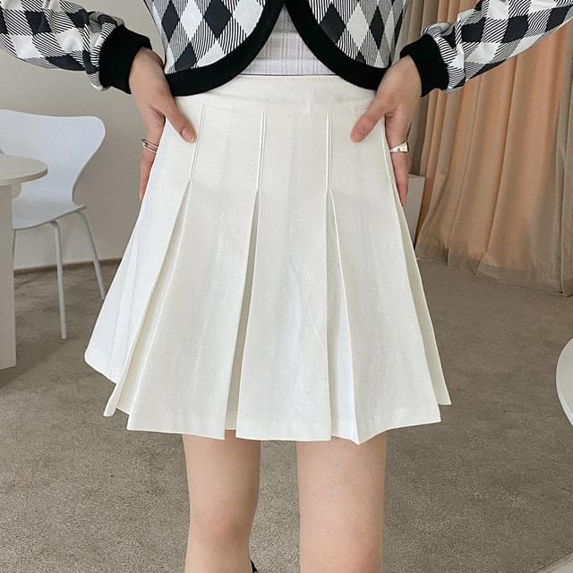 Diak pleated cotton mini skirt