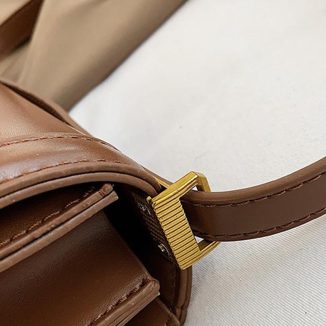 Mignon flap round line cross-body bag