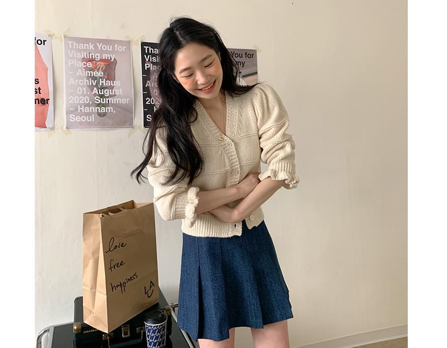 Indigo pleated mini skirt