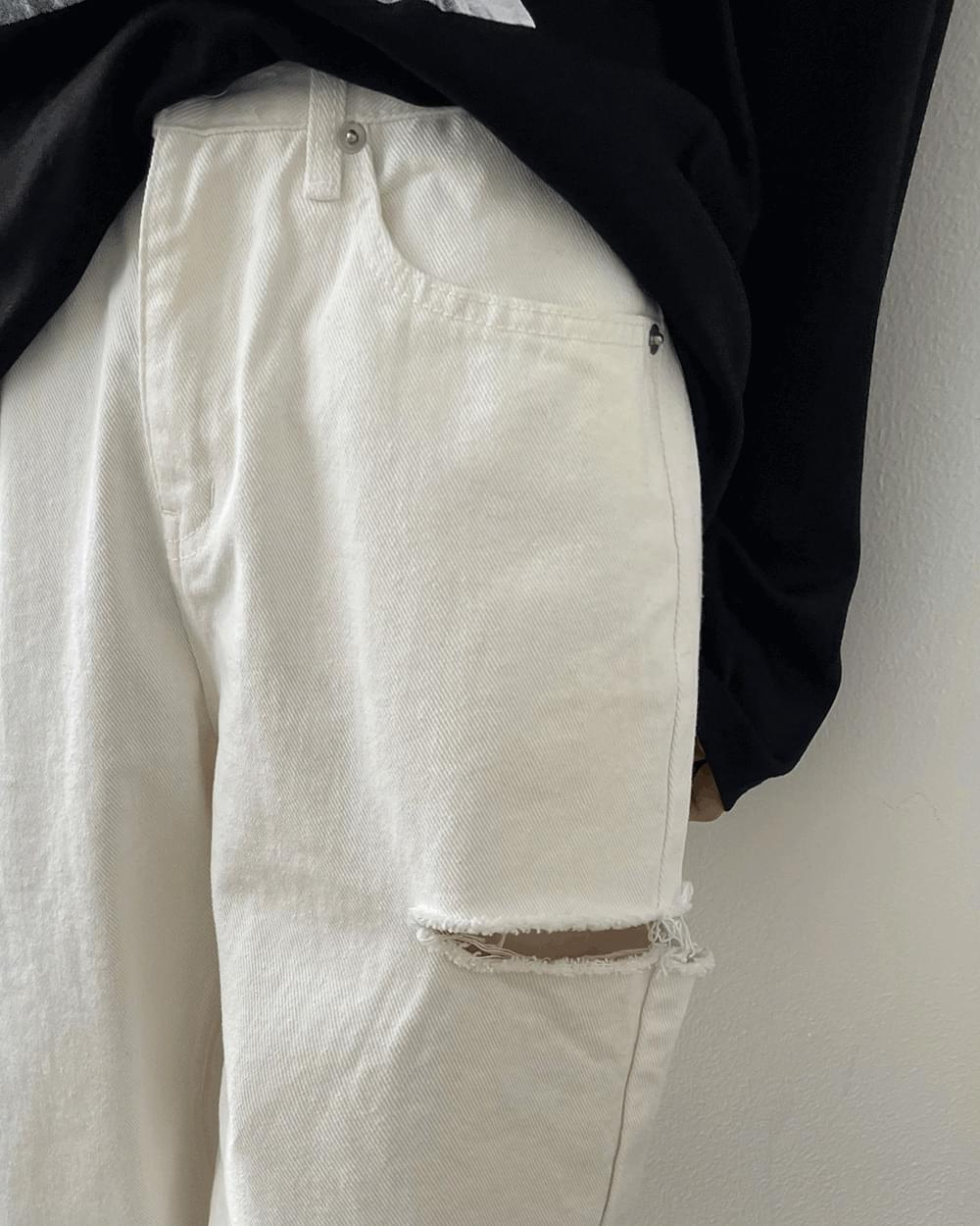 Open white wide pants next to Janer
