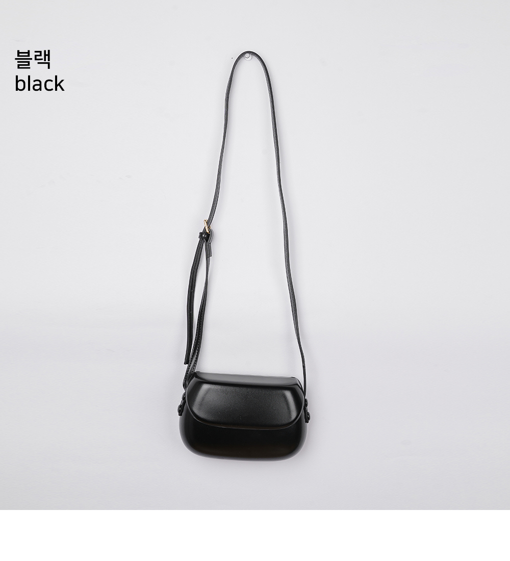 Arumong round mini crossbody bag