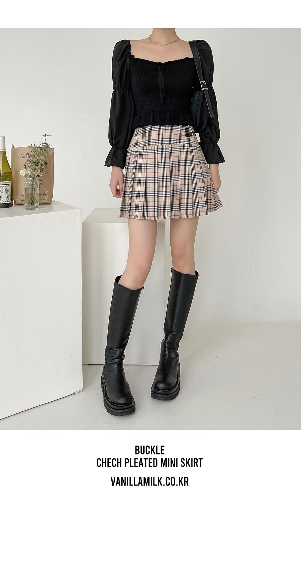 Buckle check pleated mini skirt