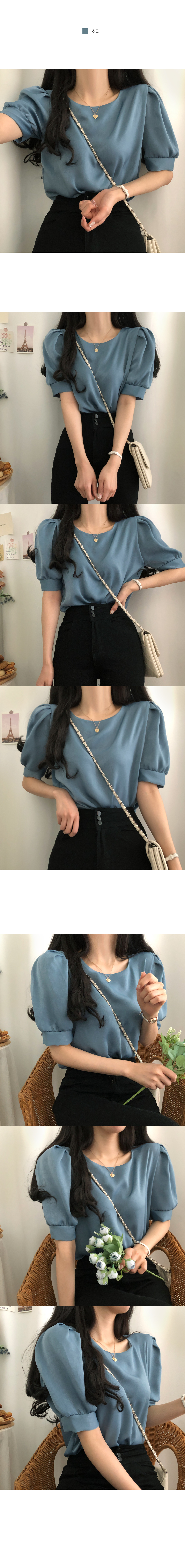 Silky short-sleeved blouse with a subtle pearl feeling