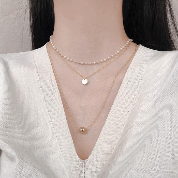 049 pearl layered 3-string necklace