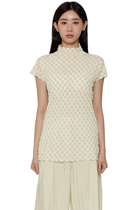 Diamond check turtleneck blouse