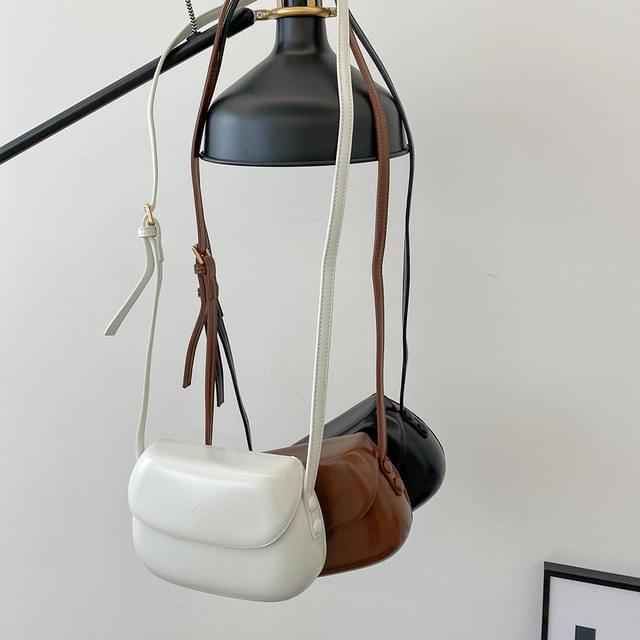 Arumong round mini crossbody bag