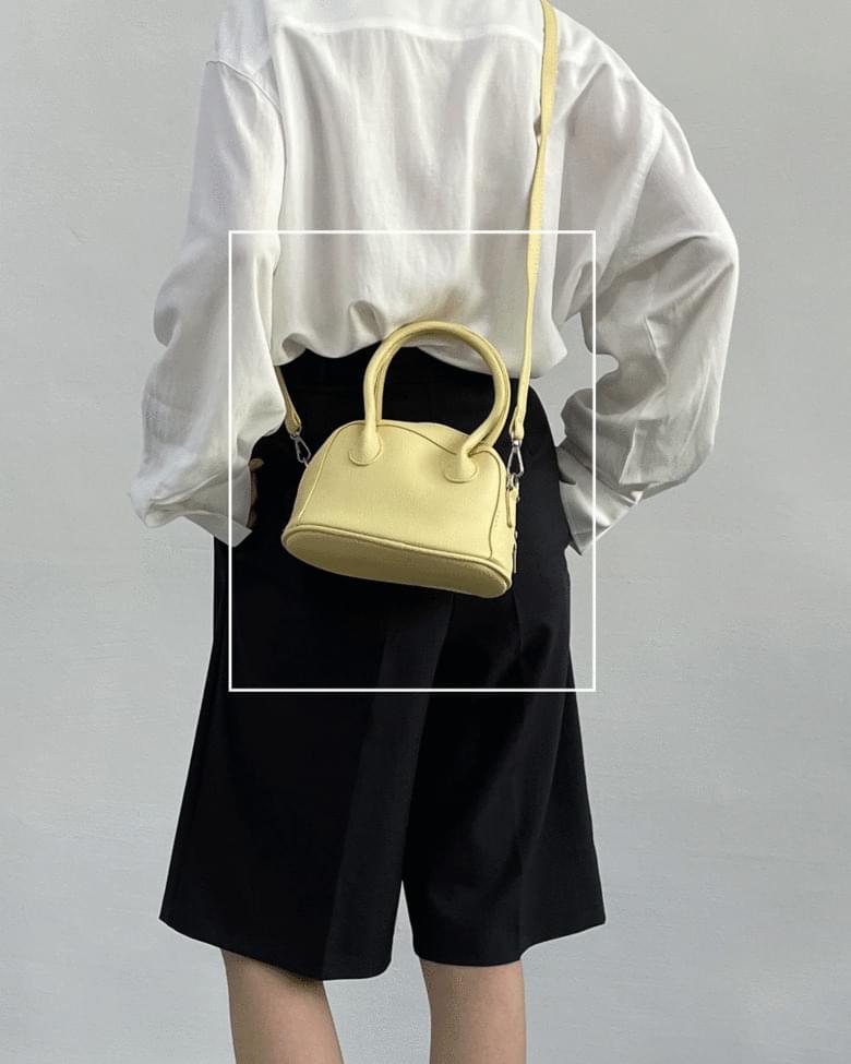 Omer mini hand cross bag