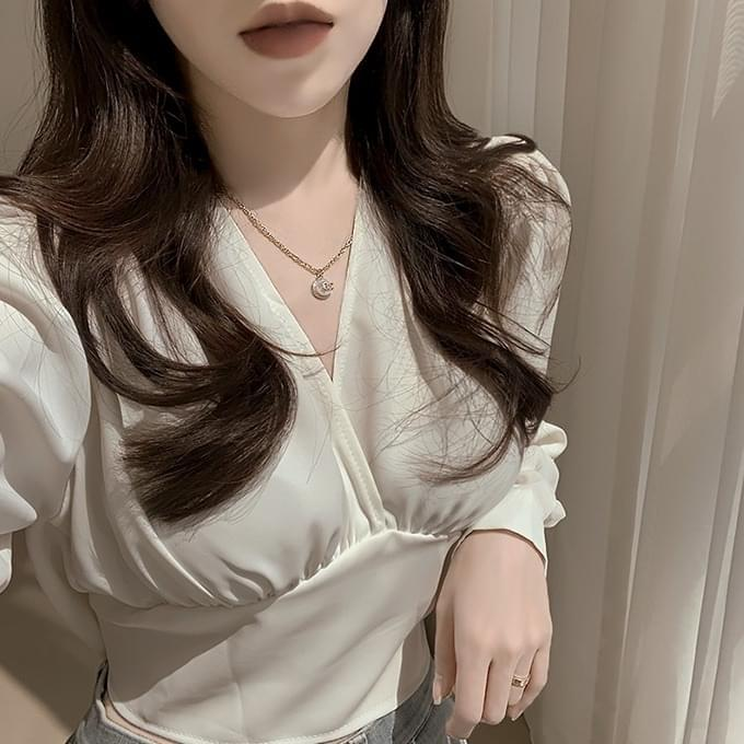 You'll be excited back ribbon shirring long sleeve blouse