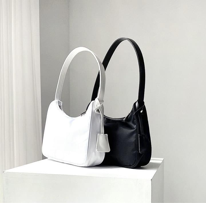 Tag Accent Shoulder Bag