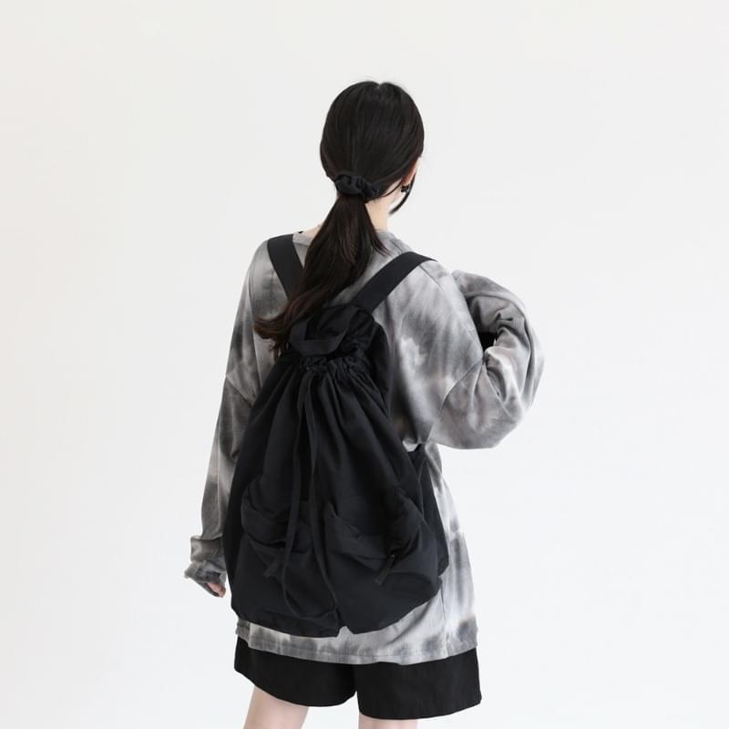 vinyl strap pocket backpack