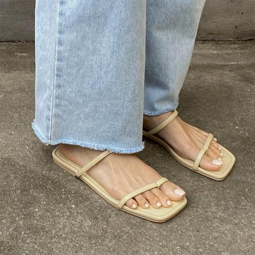 Two-strap slippers in glass