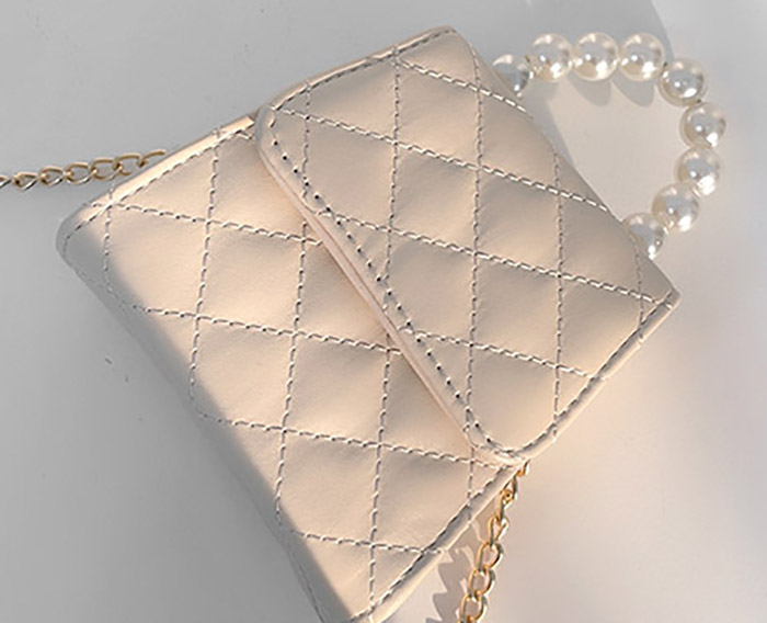 Limp pearl quilted mini cross-body bag