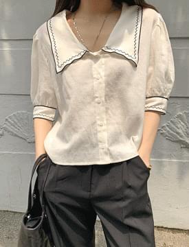 Sharp collar embroidered linen blouse