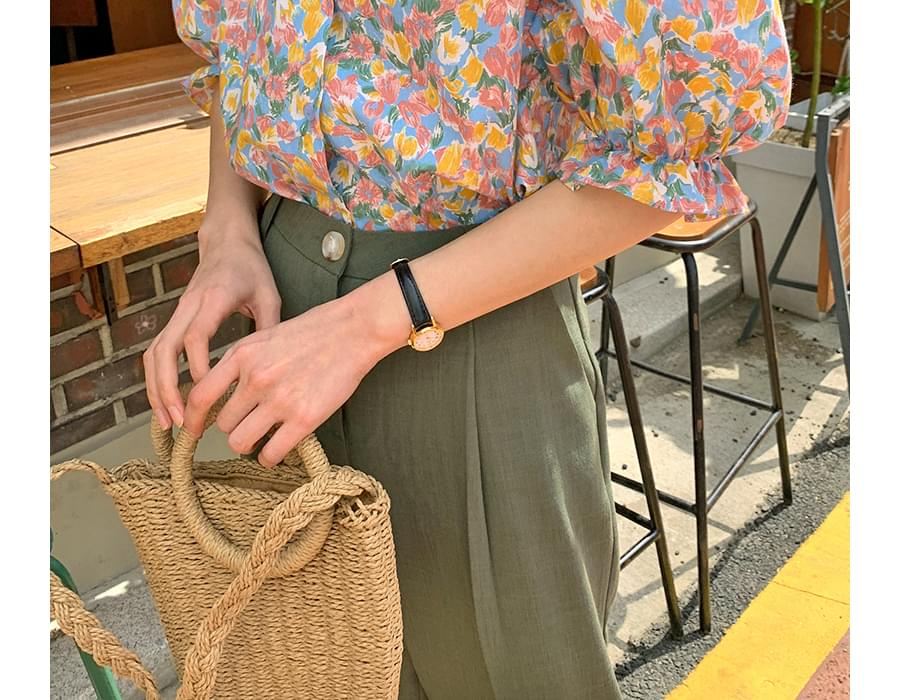 Cable strap rattan shoulder bag