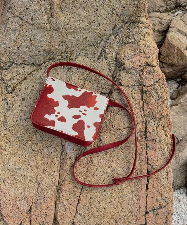 Demberoo cow mini cross-body bag