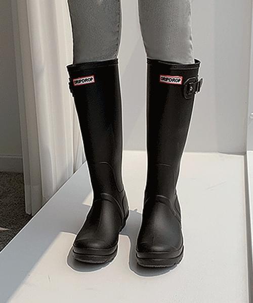 Buckle long rain boots on a rainy day