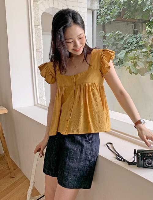 wing frill sleeveless blouse